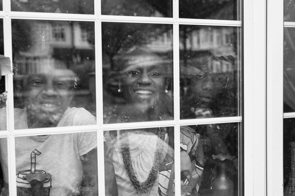 Family behind window during covid-19 pandemic in the UK.